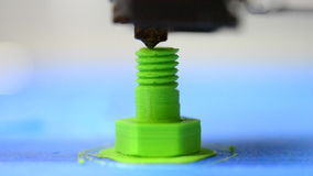 3D printer prints from the plastic figure in the form bolt. HD 1080 3D printer prints from the plastic figure in the form of a bolt closeup. 3D printer makes or