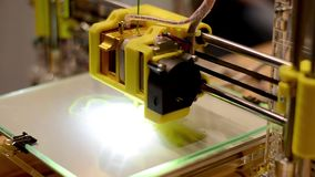 3D printer working. 3D Printer prints shape from plastic stock video footage