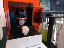 3D Printer (SLA and DLP). Stereolithography (SLA) and Digital Ligh Processing (DLP) is a form of additive manufacturing technology used for creating models Stock Image