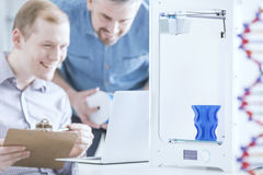 3D printer with two men stock photography