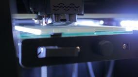 3D printer during work. Three dimensional printing machine. 3D printer during work royalty free stock photo