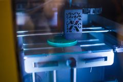 3D printer during work. Three dimensional printer during work at 3d science technology exhibition. 3D printing, additive technologies, engineering and royalty free stock photography