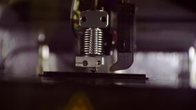 3D printer working close up. Automatic three dimensional 3d printer performs plastic. Modern 3D printer printing an object from the hot molten.shallow depth of