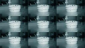 3D printer working. Fused deposition modeling, FDM. 3D printer printing. An object. Progressive additive technology for 3d printing. Multicam split screen group stock video