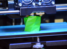3D printer works and creates an object from the hot molten plastic Royalty Free Stock Images