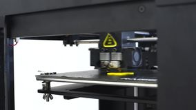 3d printing details. 3d printer for printing multi-colored toys. stock footage