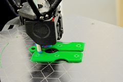 3D Printing Machine printing a piece of plastic. Working 3d printer stock photography
