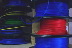 3D printing material, ABS filament, PLA & x28;Polylactic Acid& x29;,  PVA Filament.  Colored polymer in coils on the shelves. Printer, acrylonitrile, butadiene royalty free stock image