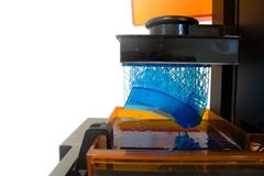 Working 3d printer. 3D printing process. Modern 3D print technology. Working 3d printer machine printing a detail. Close-up royalty free stock photography
