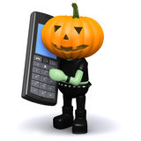 3d Pumpkin head chats on a cellphone Royalty Free Stock Photography