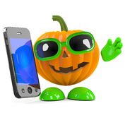 3d Pumpkin man chats on his smartphone Royalty Free Stock Image