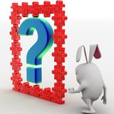 3d rabbit with blue question mark and red puzzle pieces concept Stock Photo