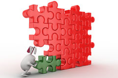 3d rabbit connect green piece in red jigsaw puzzle concept Stock Photography