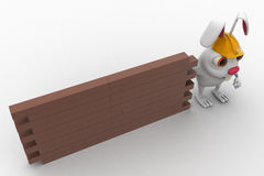 3d rabbit construction builder with brick wall concept Royalty Free Stock Photos