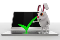 3d rabbit with correct symbol on laptop concept Royalty Free Stock Photos