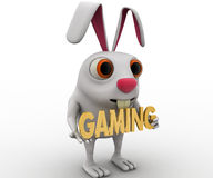 3d rabbit holding gaming text in hand concept Stock Images
