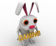 3d rabbit holding gaming text in hand concept Stock Photo