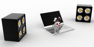 3d rabbit listen music on laptop using big and loud speaker concept Royalty Free Stock Photos