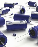 Capacitor. 3D realistic render of blue group capacitors on white background with shadow Stock Image