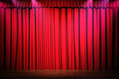 3d red curtain lit by spot lights Stock Images
