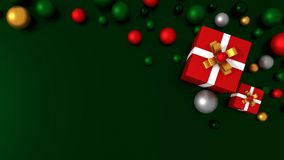 3d RED gift box  tied with a WHITE satin ribbon bow. And COLOR balls on green background.for Christmas and HAPPY new year.2018 Stock Image
