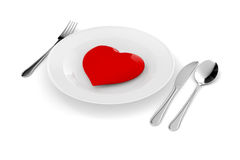 3d red heart on a plate. On white Stock Photos
