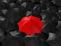 3d red umbrella among black ones Royalty Free Stock Images