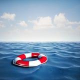 3d reddingsboei en blauwe oceaan met blauwe hemel Royalty-vrije Stock Foto's