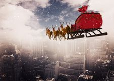 3D Reindeer sleigh riding above the city Stock Image