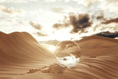3d remdering of crystal ball on desert landscape with footsteps. In the evening sunlight Stock Photos