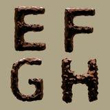 3D rendem do alfabeto do chocolate imagem de stock