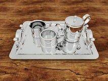 3D rendent d'une tasse de thé argentée avec des tasses sur une surface en bois Images libres de droits