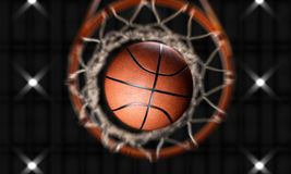 3d render Basketball fire through hoops vertical camera. And spotlight on top Stock Photo