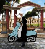 Beautiful nun riding a vespa scooter on the streets of Rome. 3D render of a beautiful nun riding a vespa scooter on the streets of Rome Stock Photo