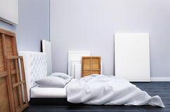 3d render bedroom with a bed and the pictures on the floor and wall. Mockup studio artist. Stock Images