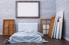 3d render bedroom with a bed and the pictures on the floor and wall. Mockup studio artist. Royalty Free Stock Photography