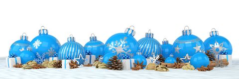 3d render - blue christmas baubles over white background. 3d render of many blue christmas baubles and anise, cinnamon sticks, walnuts and presents on snow over Stock Photo