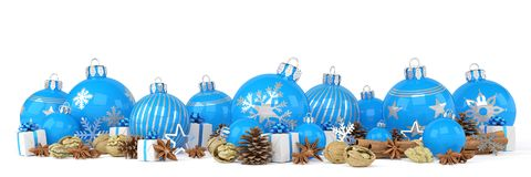 3d render - blue christmas baubles over white background. 3d render of many blue christmas baubles and anise, cinnamon sticks, walnuts and presents over white Royalty Free Stock Photo