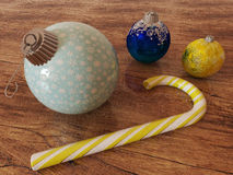 3D render of blue and gold holiday decoration baubles with candy cane Royalty Free Stock Images