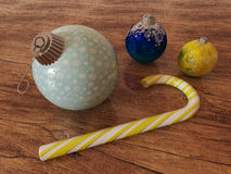 3D render of blue and gold holiday decoration baubles with candy cane Royalty Free Stock Image