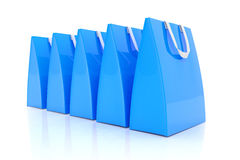 3d render - blue shopping bags. 3d render - Five blue shopping bags over white background Stock Photos