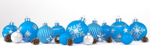 3d render - blue and silver christmas baubles over white backgro. 3d render of many blue and silver christmas baubles and christmas decorations over white Royalty Free Stock Images