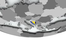 Bosnia with flag on globe Stock Photo