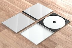 CD DVD Disc plastic box mockup. Perspective view. 3d render of a cd dvd compact disc plastic box mockup on wooden background. Perspective view Stock Photos