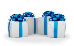 3d render - christmas gift boxes with blue ribbons. 3d render - White christmas gift boxes with blue ribbons over white background Royalty Free Stock Images