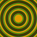 3D render of  concentric circles incresing in size, filling the frame. 3D render of brown, green and yellow concentric circles incresing in size, filling the Stock Photos