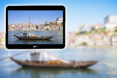 3D render concept image with a digital tablet showing a typical portuguese wooden boats, called Barcos Rabelos, used in the past stock image