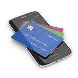 3d render of credit cards lying on mobile phone Stock Photography