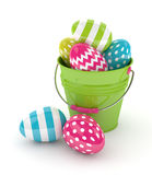 3d render of Easter eggs and bucket. Isolated over white background Royalty Free Stock Photography
