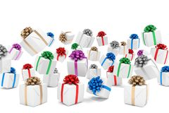 3d render of falling christmas presents. With colorful ribbons over white background Royalty Free Stock Photos